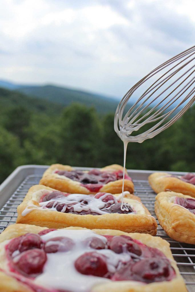easy cherry cream cheese danish coated with frosting