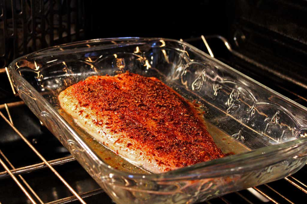 salmon fillet baking in oven
