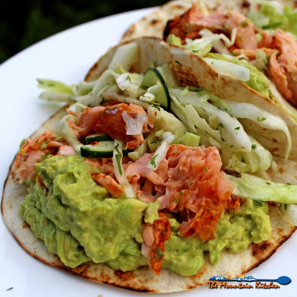 Fresh and simple, the tangy dill slaw with cucumbers adds a nice crunch, offset by smooth avocados the perfect match to the heat to Ina's salmon tacos.