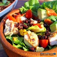 This Grilled Chicken Southwest Salad is packed with black beans, tomatoes, grilled corn, bacon, avocado and romaine lettuce, topped with BBQ Ranch Dressing. | TheMountainKitchen.com