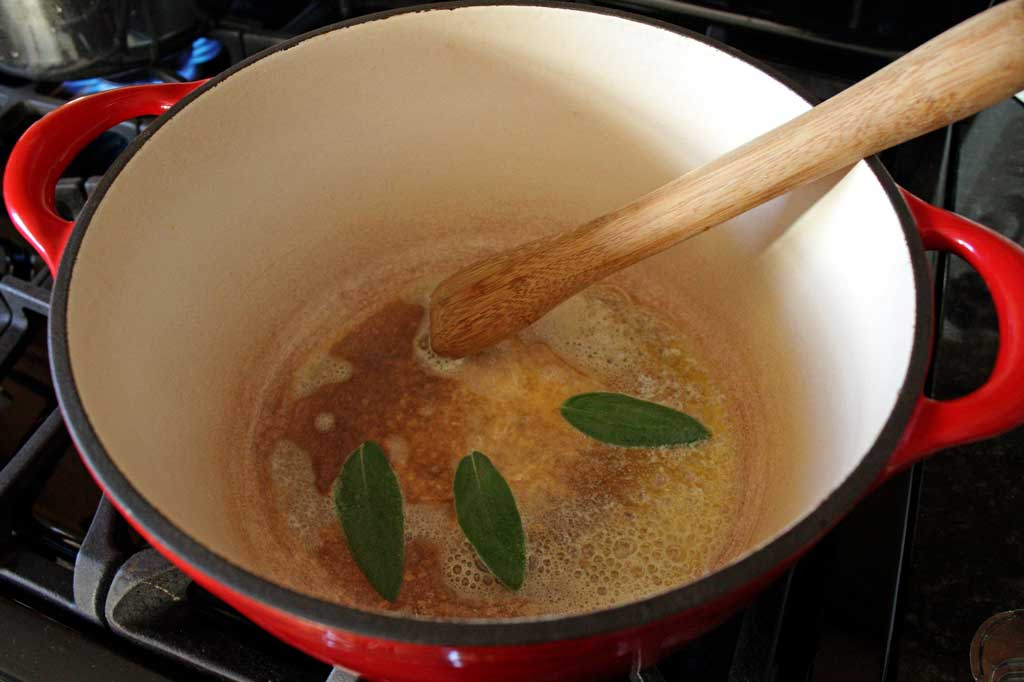 sage and melted butter in pot