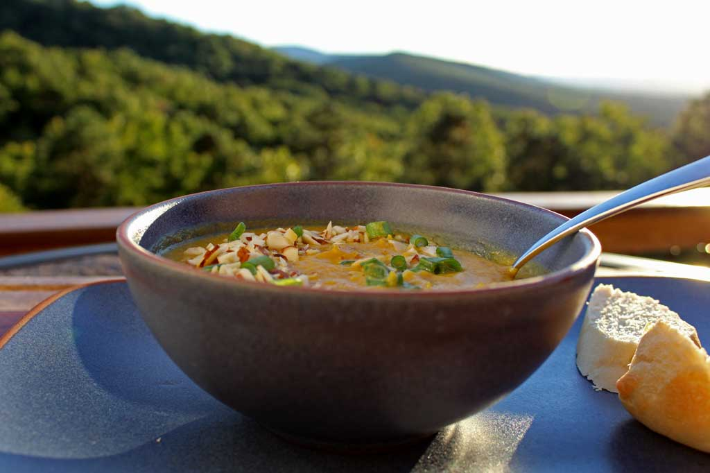 This easy vegetarian roasted pumpkin soup with almonds and sage is a creamy, velvety smooth soup, yet healthy way to start a fall dinner or as meal itself!   TheMountainKitchen.com