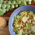 This apple pecan brussels sprout salad is for crunch lovers! Made with shredded brussels sprouts, apples, pecans, parmesan cheese and homemade dressing. | TheMountainKitchen.com