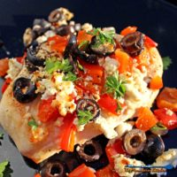 Quick and easy, the chicken breasts in this Mediterranean Chicken dish are basted in lemony broth with red bell peppers, black olives and tangy feta cheese. | TheMountainKitchen.com
