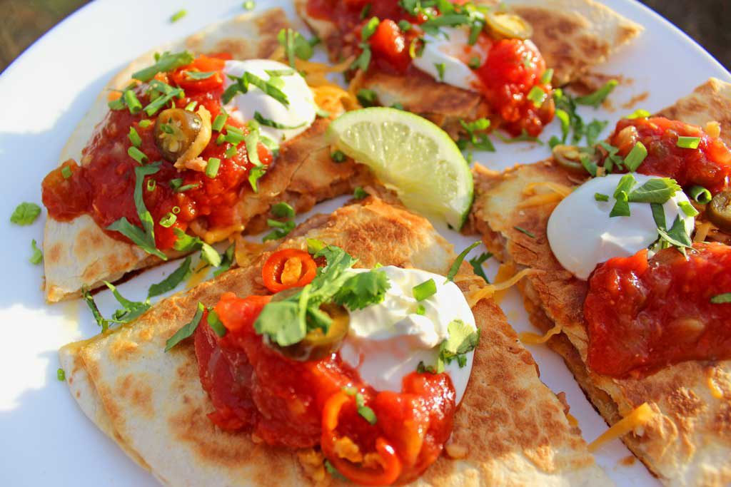 These refried bean and cheese quesadillas, filled with refried beans, roasted poblano peppers and cheese and can be made with unlimited vegetarian toppings.   TheMountainKitchen.com