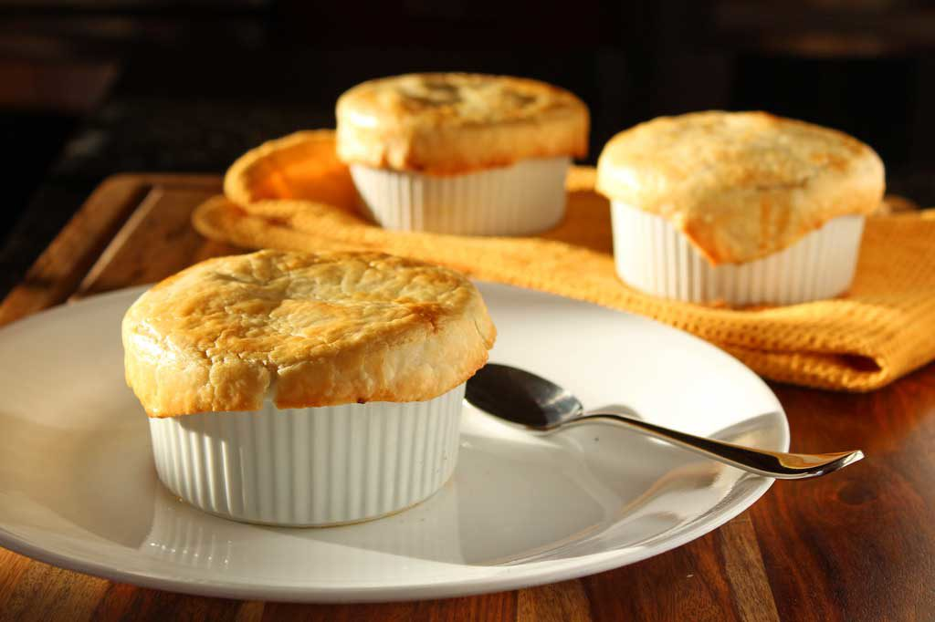 Healthy mushroom pot pies have the comfort of traditional pot pies without all the calories. Mushrooms smothered in cauliflower sauce with flaky crust. Yum!