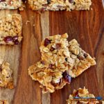 A yummy grab and go breakfast or snack, these wholesome homemade granola bars are easy to make, packed with rolled oats, and toasted coconut mixed combined with a sticky honey brown sugar sauce, with chopped fruit and nuts. Perfect for when there isn't time to cook, you can simply grab and go! | TheMountainKitchen.com