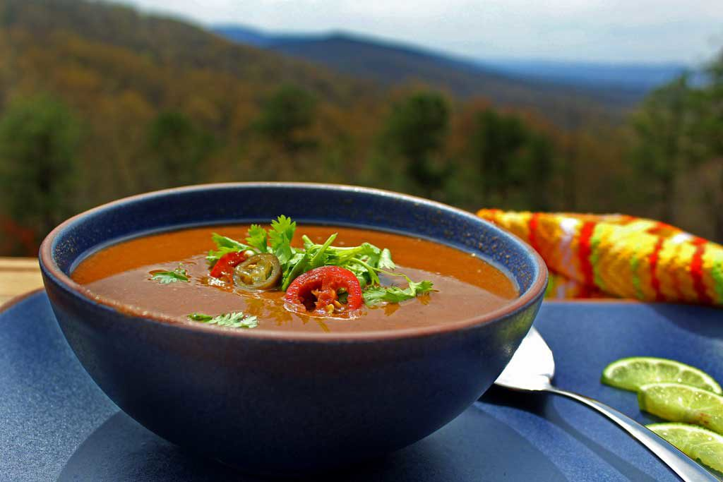 bowl of black bean soup with mountain view