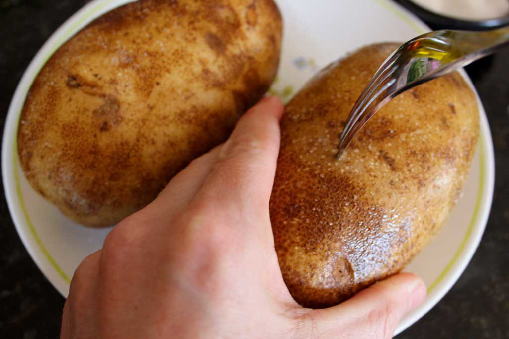 piercing potato with fork