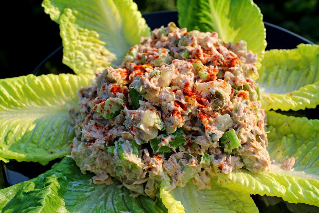 This simple recipe for classic tuna fish salad is made with canned tuna, homemade mayonnaise, and a celery sweet pickle relish. With only a few ingredients you can have a simple tuna salad that's perfect for as is in a sandwich, wrap, or served as an appetizer!   TheMountainKitchen.com