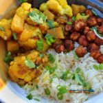 With rich flavors of spice and chilis typically found in Indian cuisine, serve this cauliflower stew with rice and chickpeas. It will leave you spellbound! | TheMountainKitchen.com