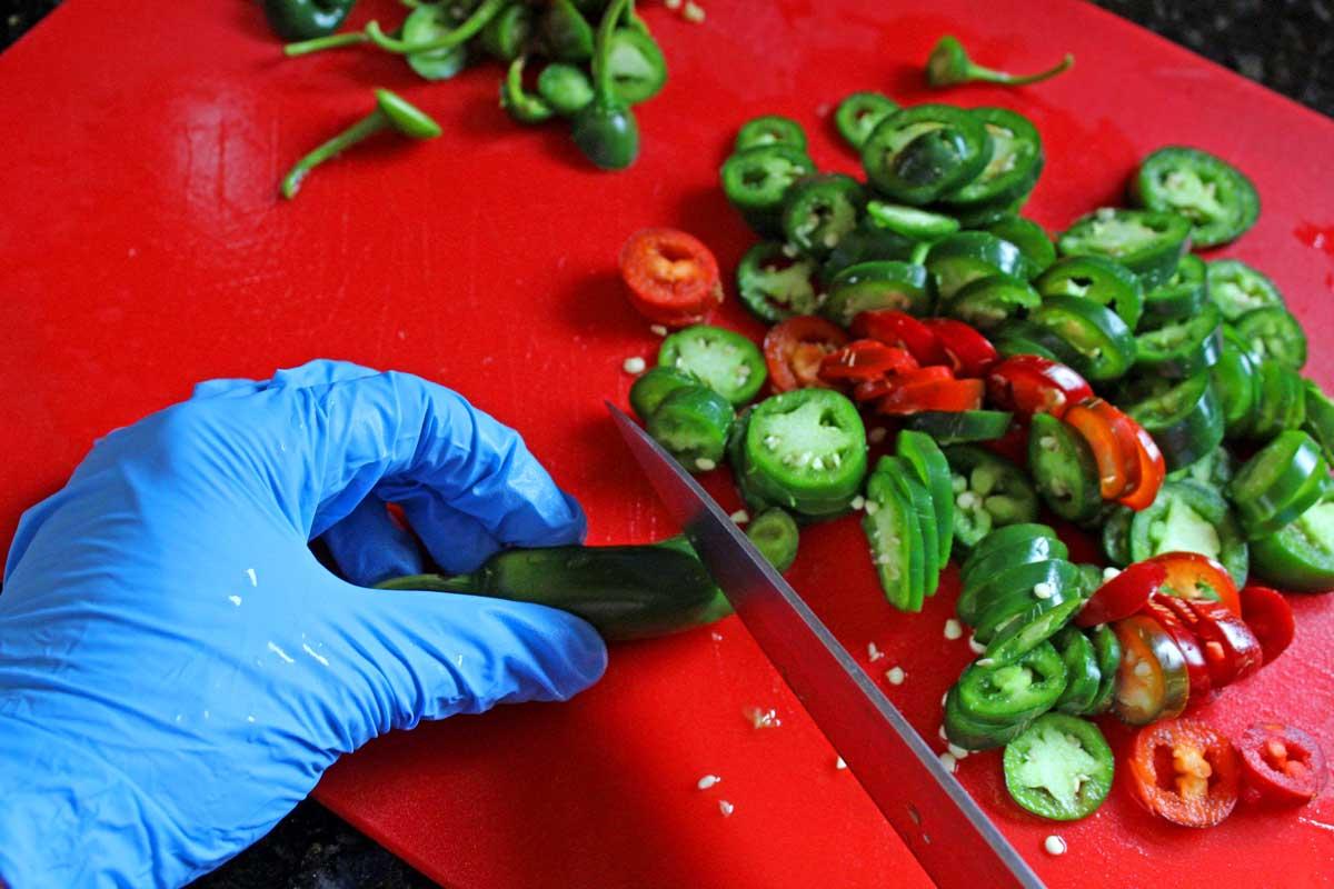 slicing jalapenos wearing gloves