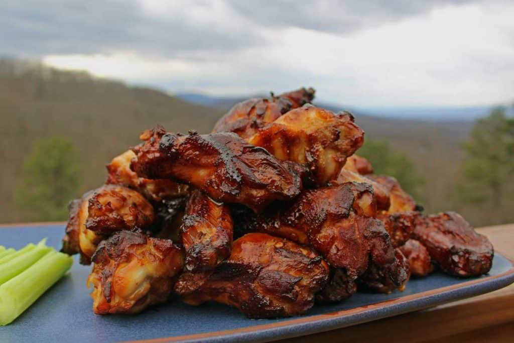 a platter of wings with the mountains in the background