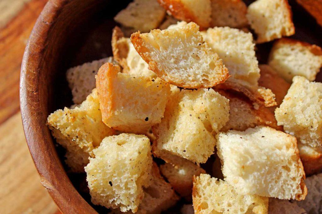 A closeup shot of homemade croutons in a bowl.