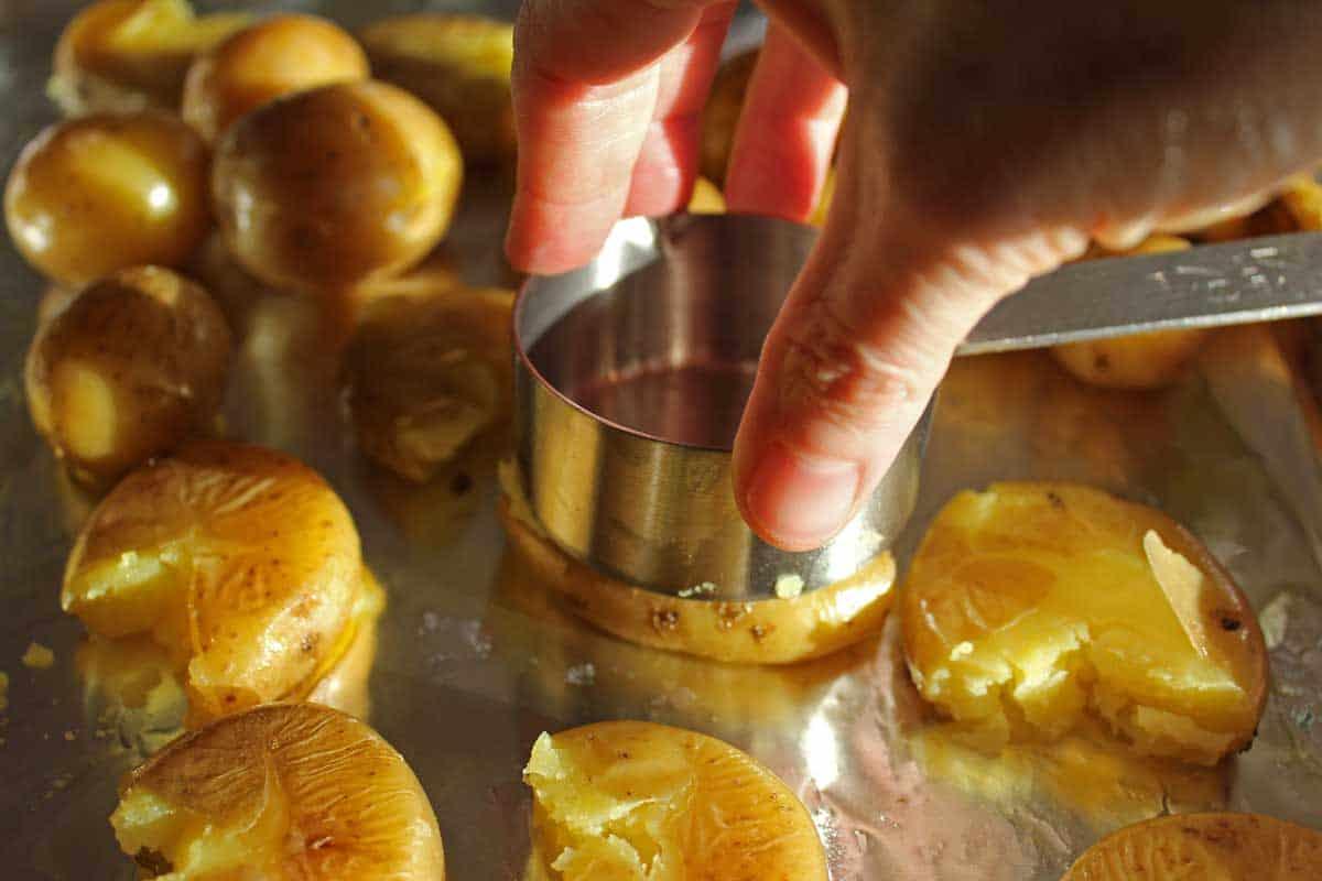 Smashing a potato on a sheet pan.