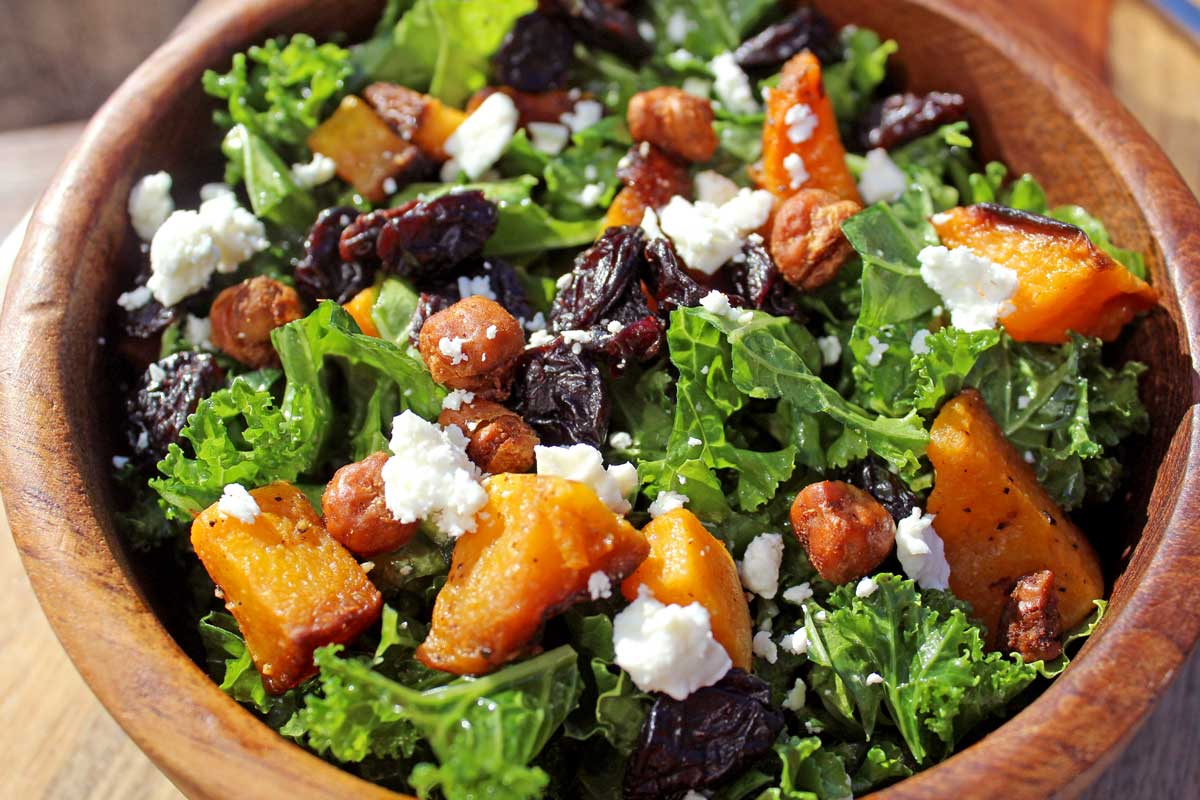 a bowl of butternut squash kale salad