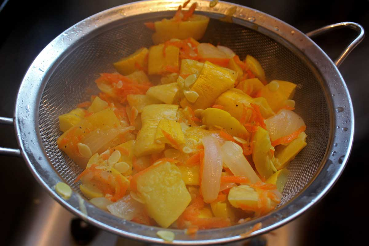 vegetables straining in a sieve