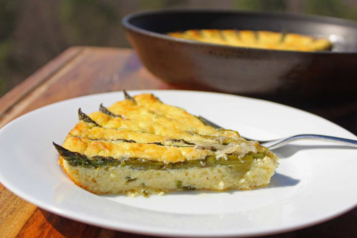 Celebrate spring with this crustless asparagus ricotta quiche! Gluten-Free and Low-Carb, this quiche is full of ricotta cheese and farm fresh asparagus.