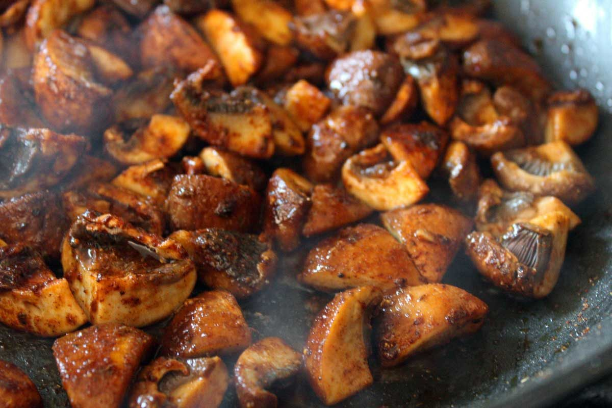 seasoned mushrooms in pan