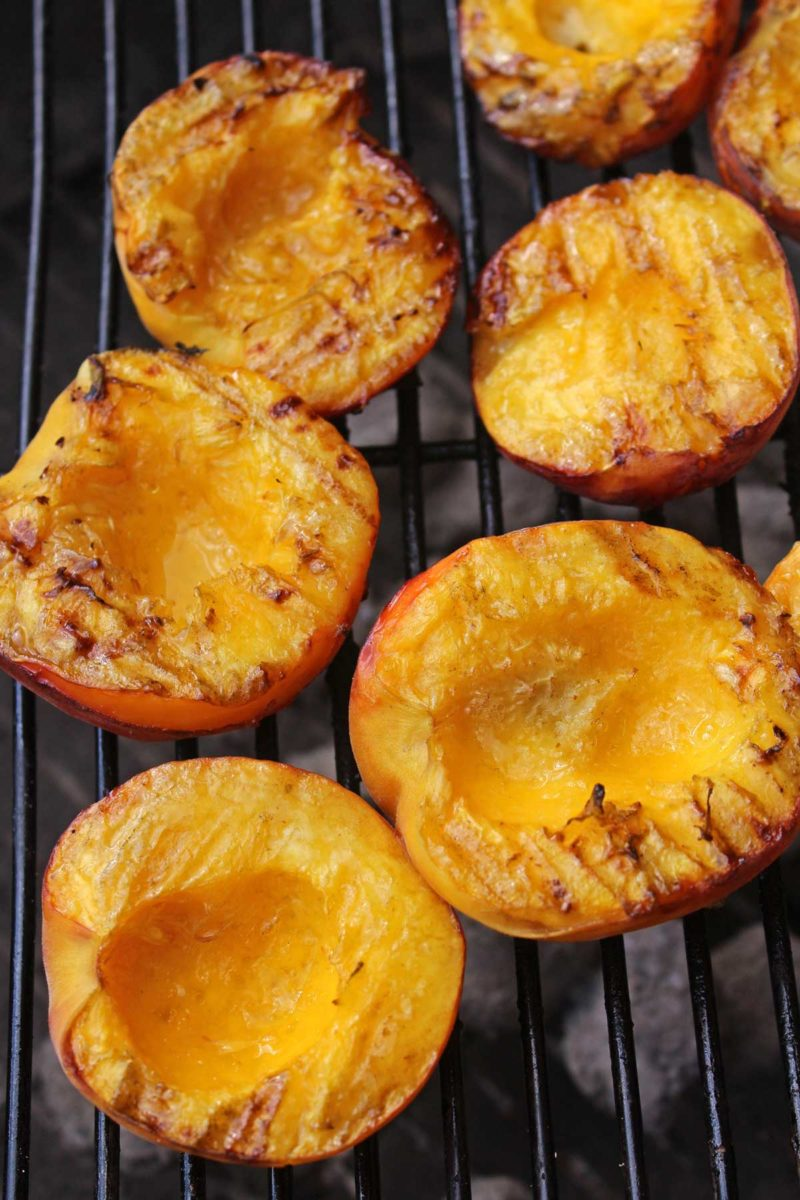 juicy grilled peaches on grill