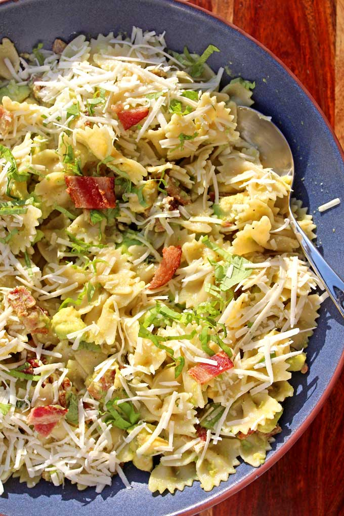 Bacon Avocado Pasta is made of bow-tie pasta tossed with creamy avocado, and crispy bacon and a garlicky dressing. A great weeknight dinner in no time!