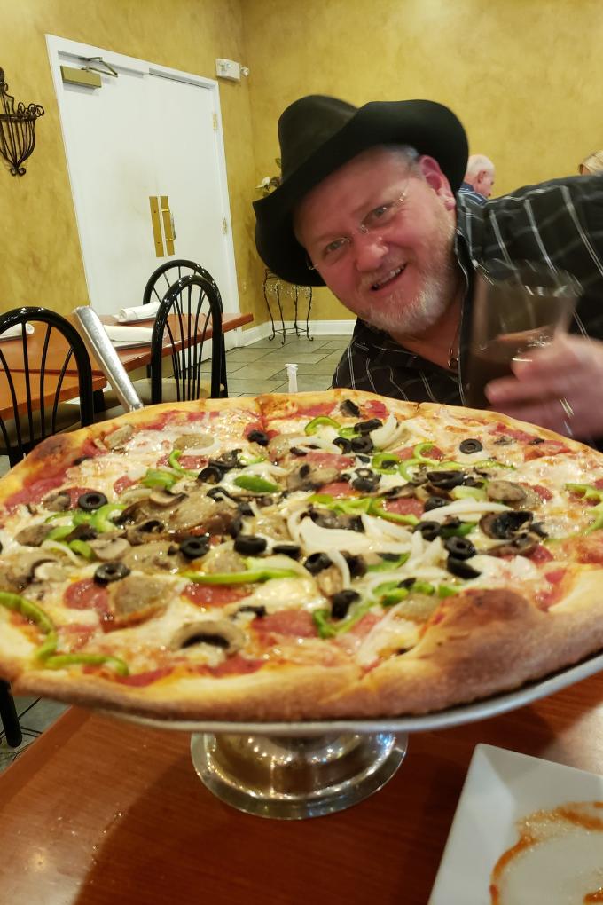 david admiring large pizza