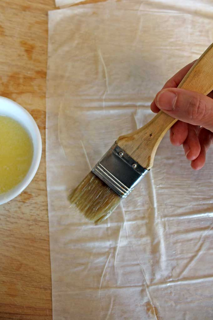 brushing phyllo dough with butter