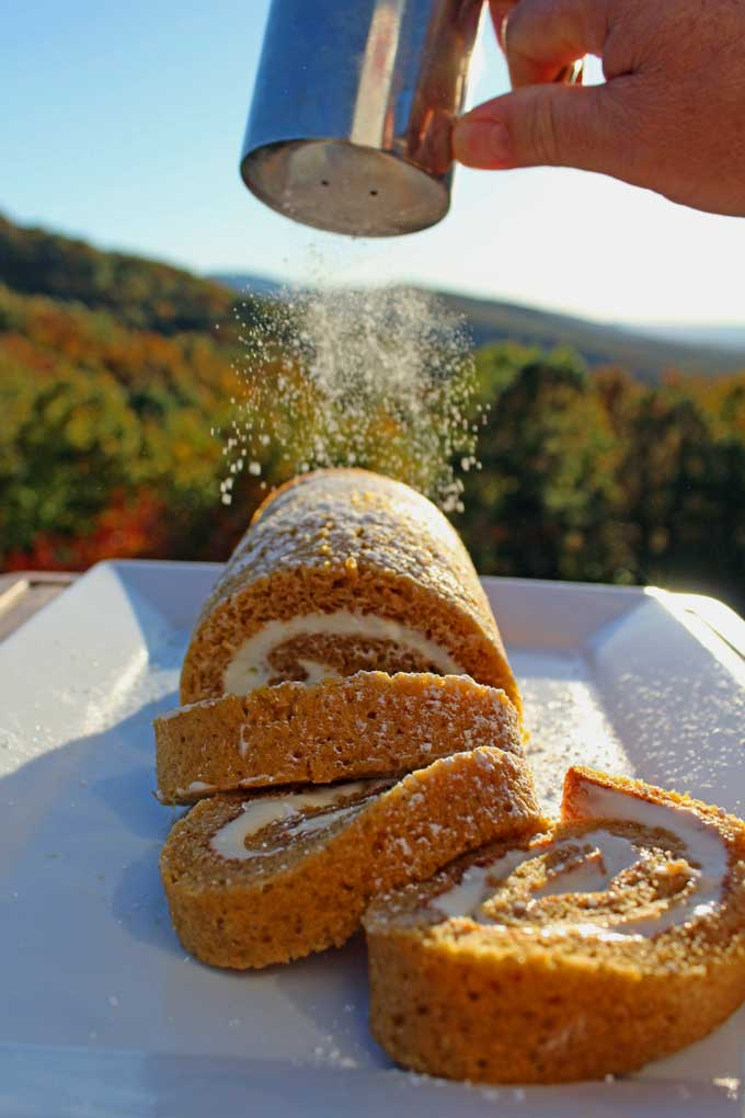 This easy pumpkin roll recipe is a classic dessert made of delicately sweet and warmly spiced cake curled up around silky cream cheese that everyone adores!