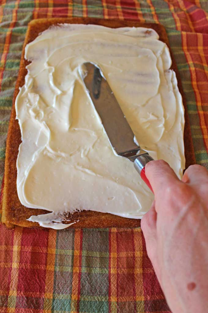 spreading filling onto cake with offset spatula