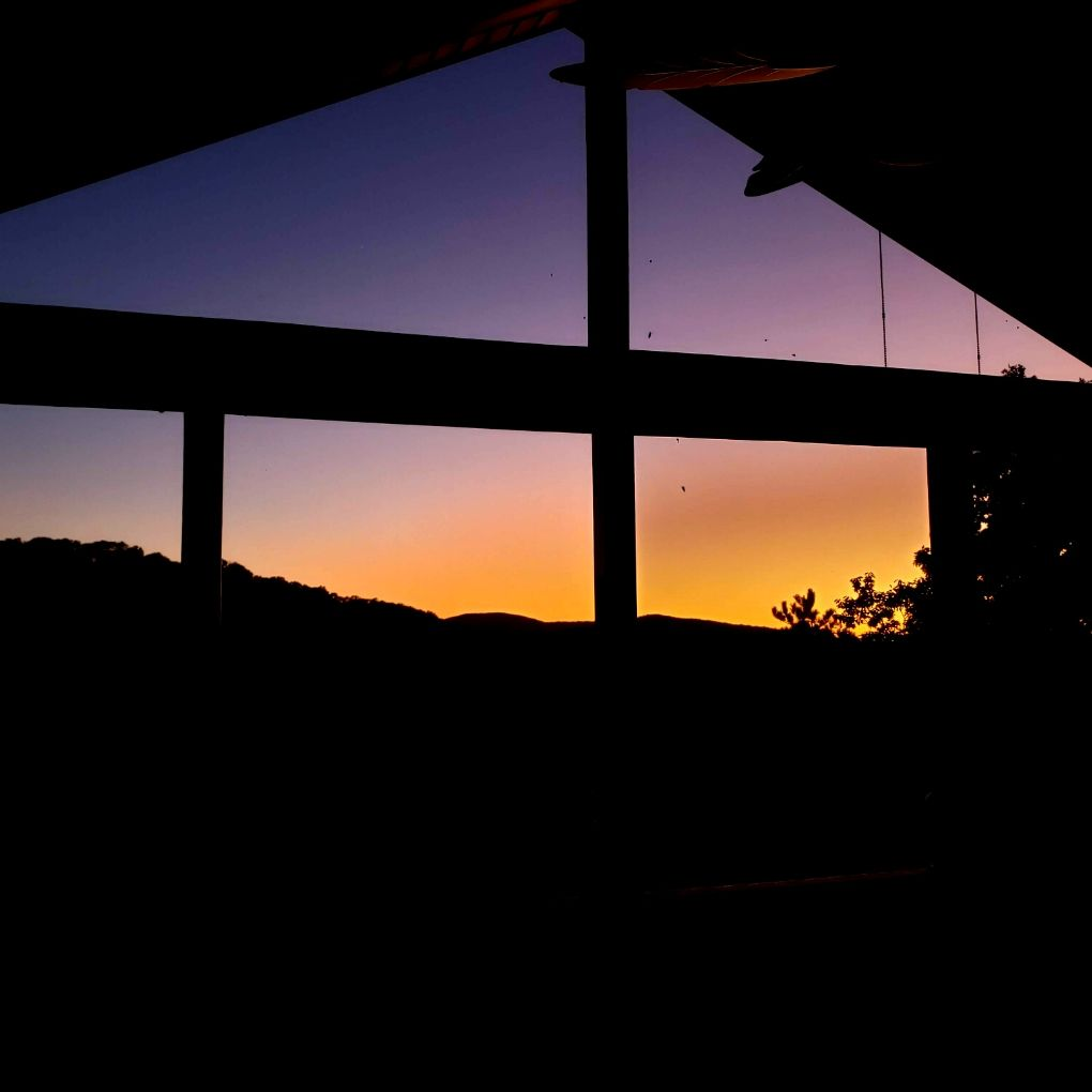 mountain sunset through our screen porch