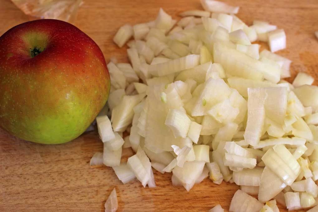 apple and chopped onion on cutting board