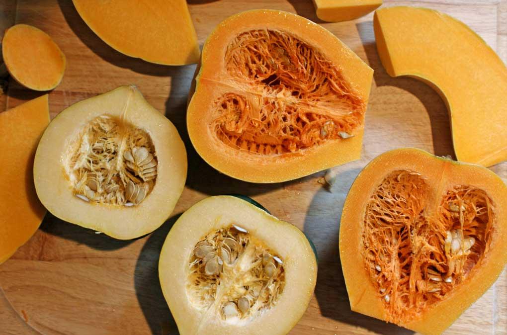 cut pumpkin and squash laying on cutting board
