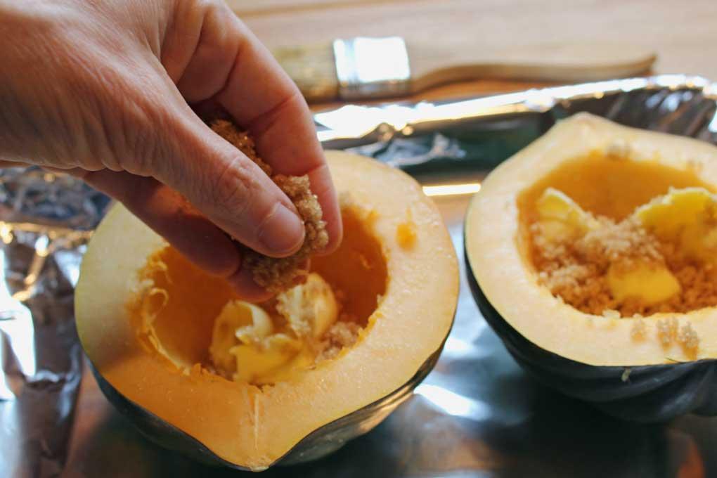 sprinkling brown sugar mixture inside acorn squash