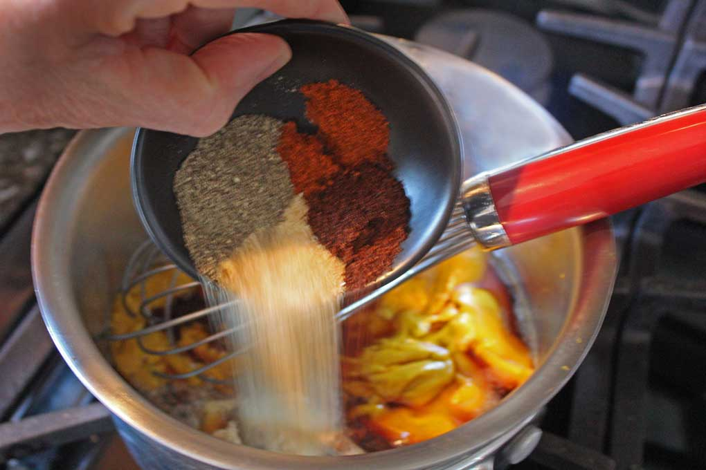 pouring spices into saucepan