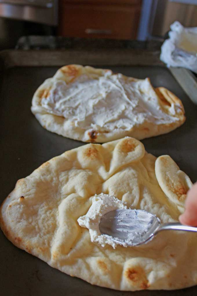 spreading ricotta onto flatbread