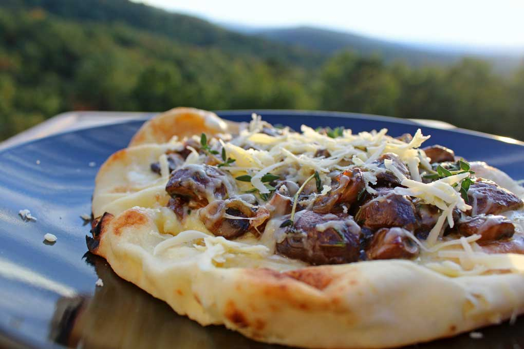 mushroom flatbread pizza with mountain view