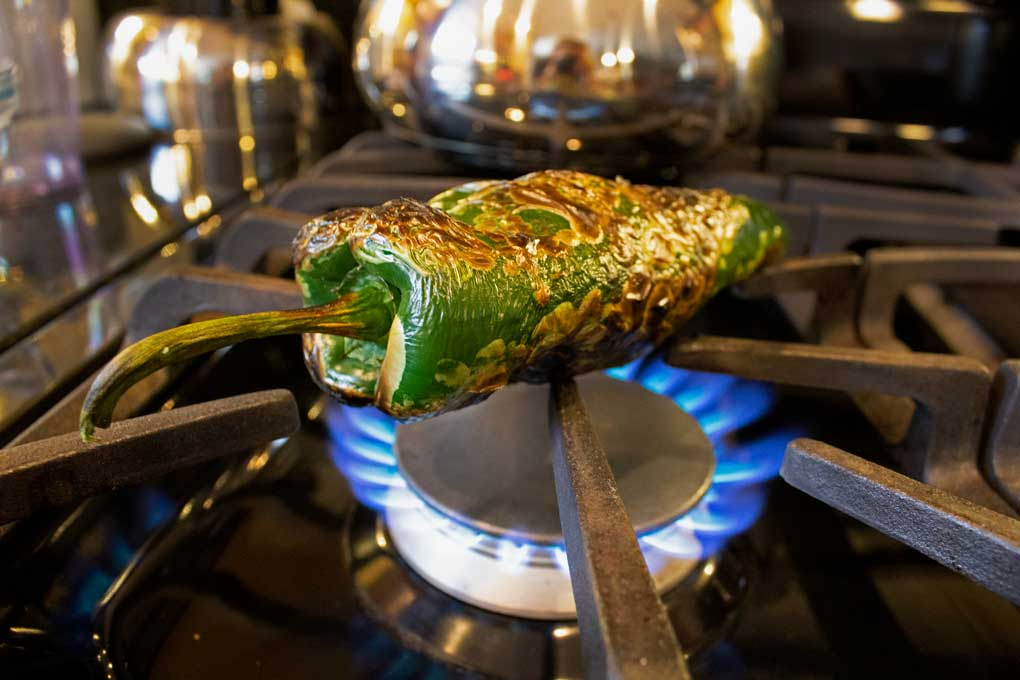 poblano fire roasting on stove