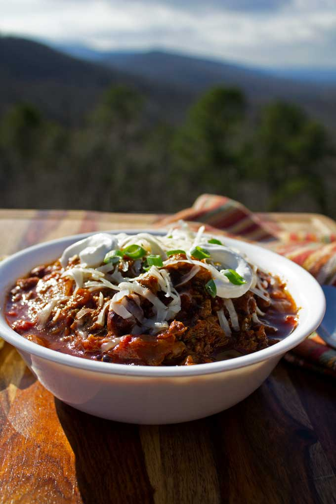 smoked brisket chili in bowl with mountain view