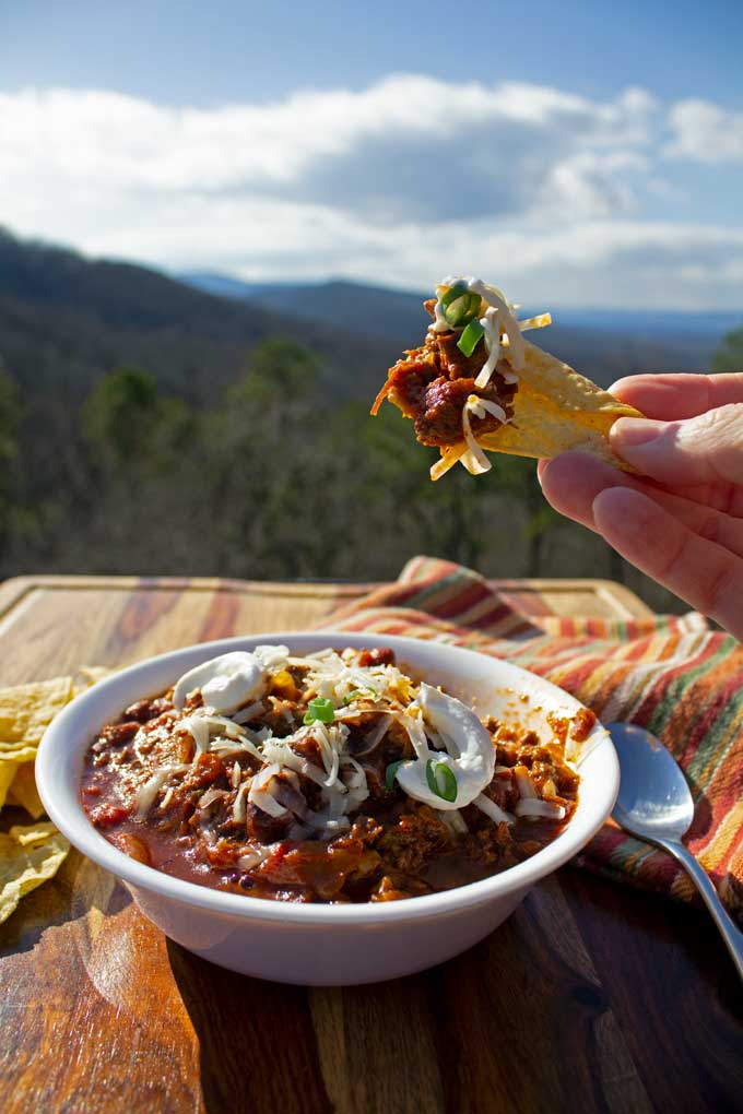 chili on tortilla chip with mountain view
