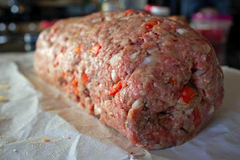 raw meatloaf ready to be wrapped in bacon