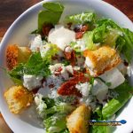casesar salad with pepperoni bits and feta