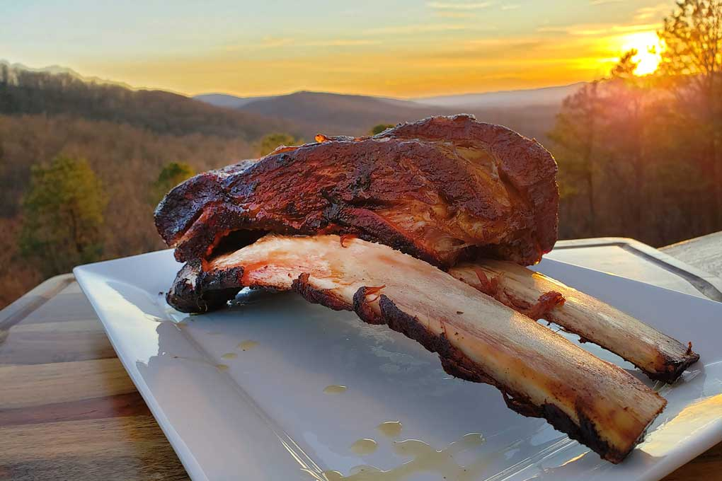finished smoked beef short ribs with mountain sunset