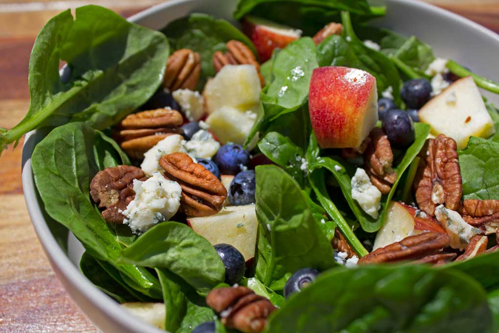 blueberry spinach salad in bowl