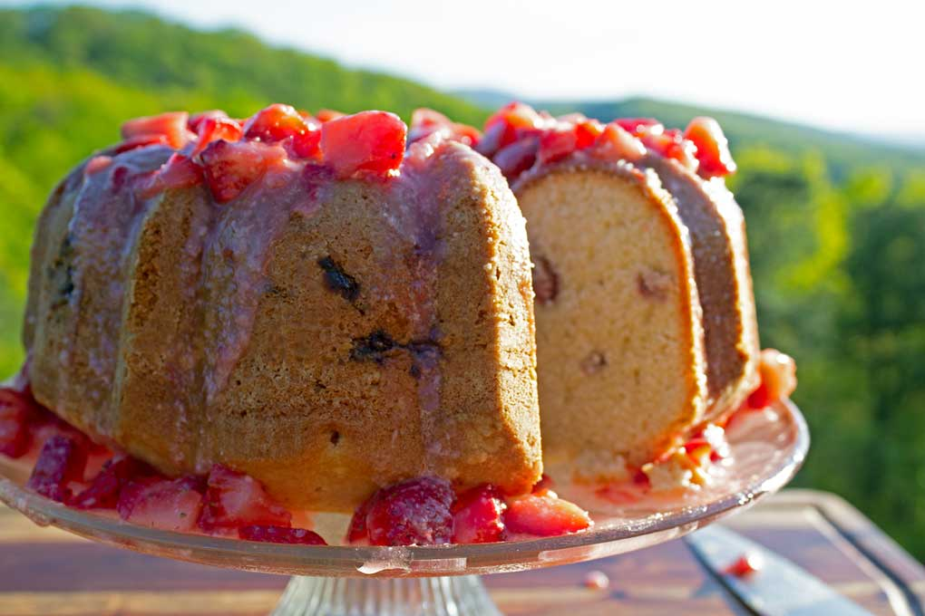 strawberry bundt cake sliced with mountain view