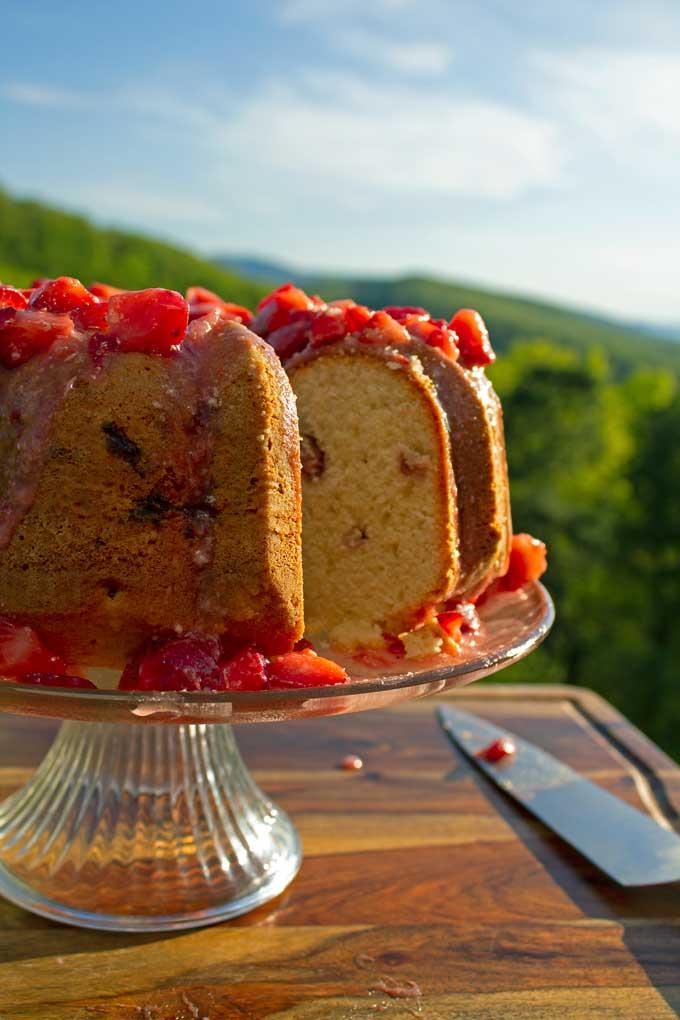 strawberry bundt cake with strawberry glaze with mountain view