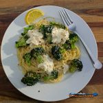 Air fryer broccoli with ricotta and pasta on a plate with fork