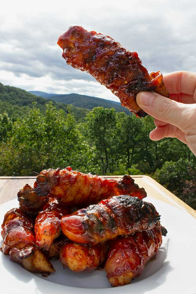 Tailgate in your yard! Grill bacon-wrapped BBQ chicken tenders, a tender, juicy, smoky, sticky-sweet mouth full of flavor with every bite!