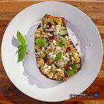 Mediterranean quinoa-stuffed eggplant on plate