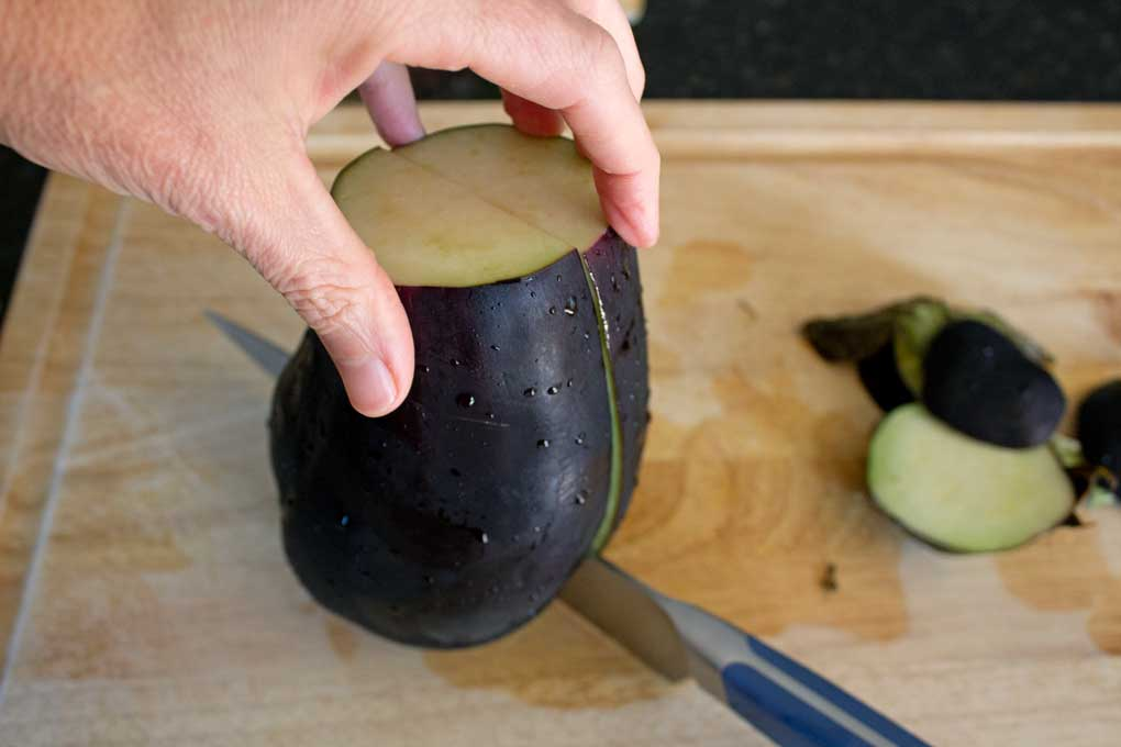 slicing eggplant with knife