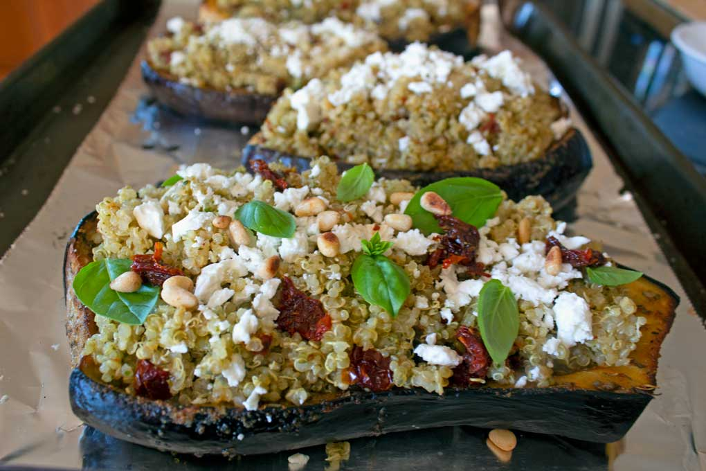 Mediterranean Quinoa-Stuffed Eggplant on baking sheet